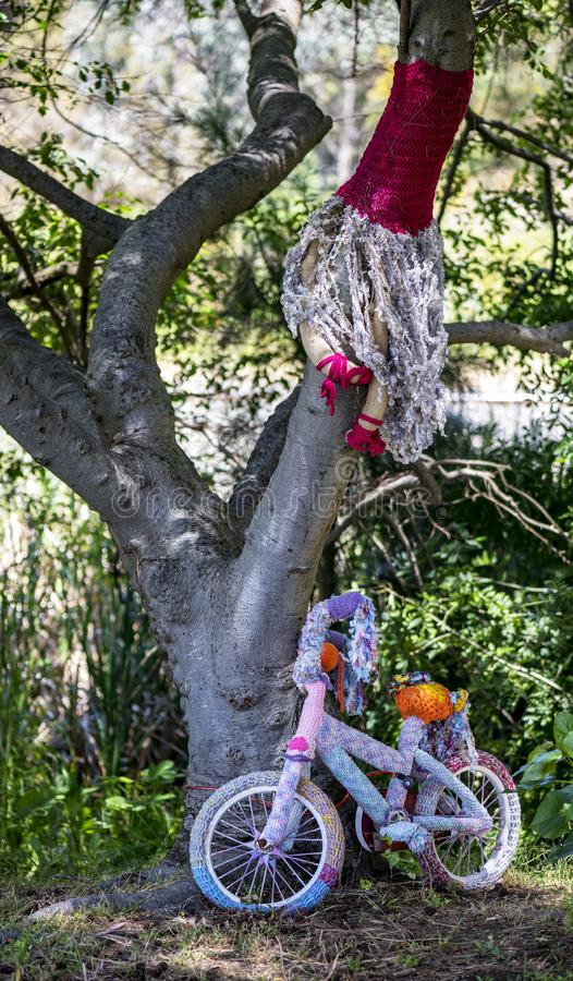 Yarn Bomb in Waroona. In the town centre trees are decorated with crochet knitting called yarn bombs. Interesting method of attracting tourists to the small stock images