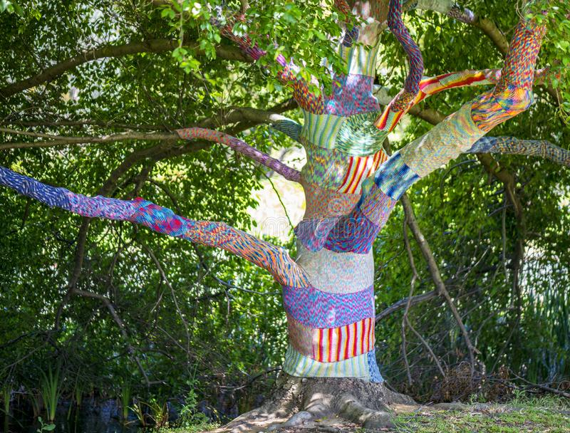 Yarn Bomb in Waroona. In the town centre trees are decorated with crochet knitting called yarn bombs. Interesting method of attracting tourists to the small stock photography