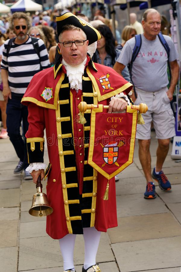 Town Crier Welcoming Shoppers to a Young Traders Market. royalty free stock photos