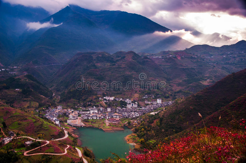 Town at edge of Yangtze river. The small town at the edge of Yangtze river with full of red leaves which was shining under sunshine in China royalty free stock images