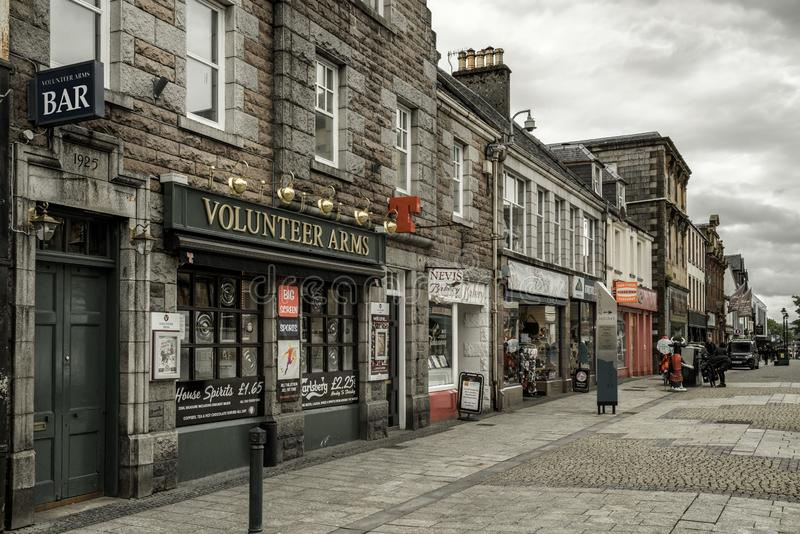 Town Fort William, Scotland. FORT WILLIAM, SCOTLAND - MAY 22: Shops at centre of city on May 22, 2018 in Fort William royalty free stock photo