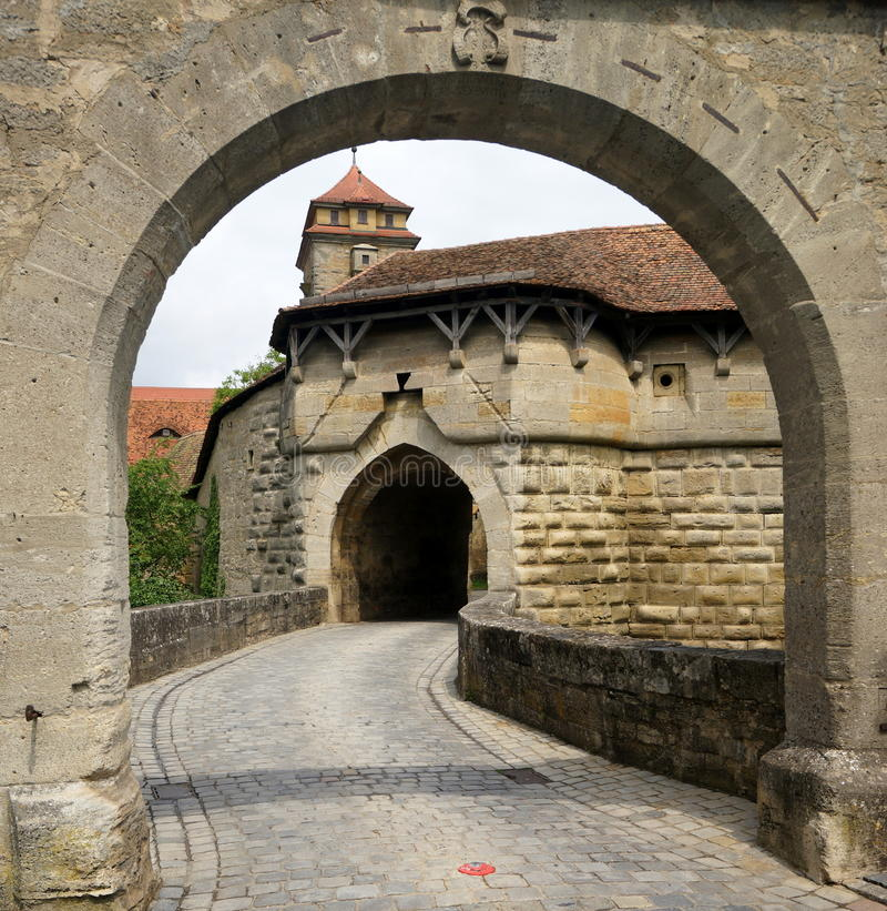 Town Gate at Rothenburg. This is the first of a series of four gates leading into the town of Rothenburg. Rothenburg ob der Tauber is a town in the district of stock photography