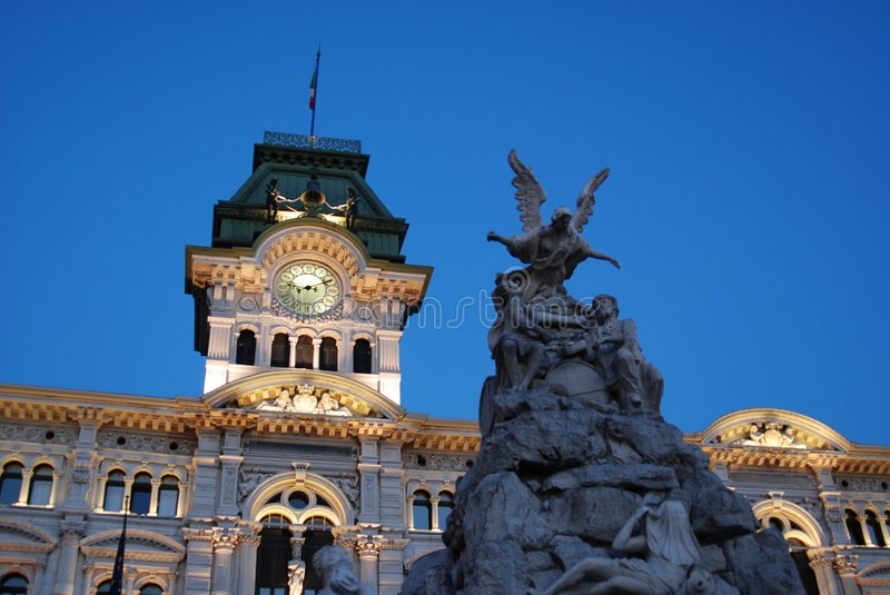 Town Hall. Piazza Unità d'Italia with illuminated Town hall and fountain at dusk / night - Trieste - Italy 2007 royalty free stock photos