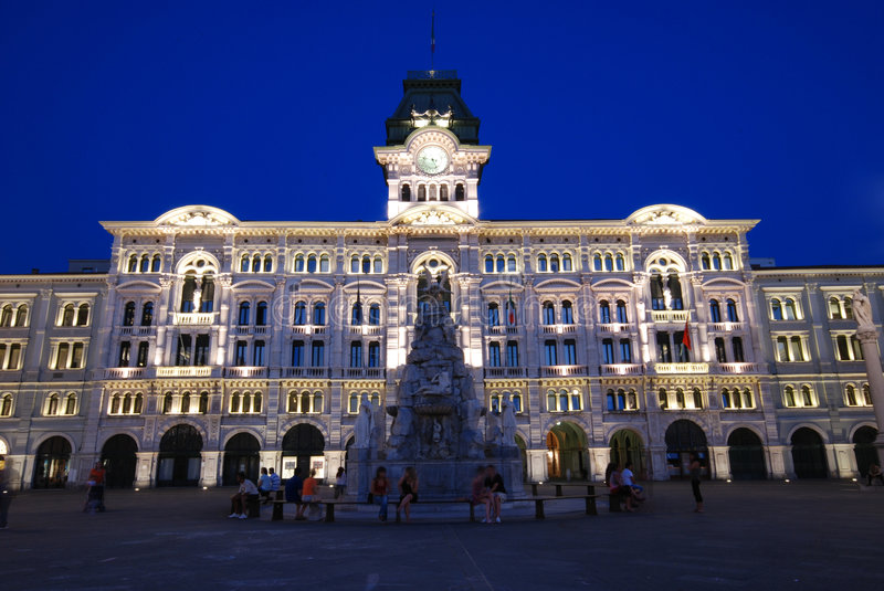 Town Hall. Piazza Unità d'Italia with illuminated Town hall, buildings and fountain at dusk / night - Trieste - Italy 2007 royalty free stock photography