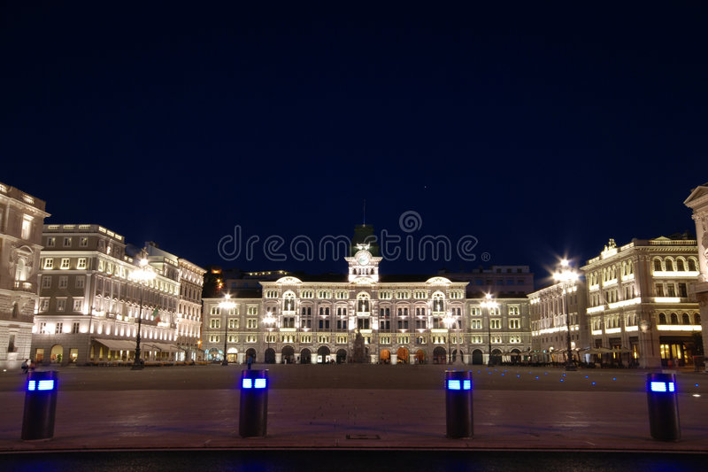 Town Hall. Piazza Unità d'Italia with illuminated Town hall and buildings decorations at dusk / night - Trieste - Italy 2007 stock image