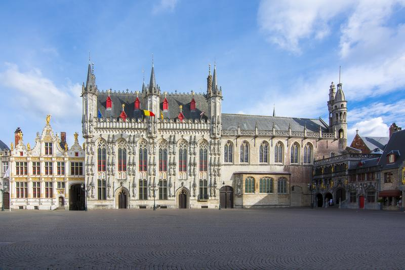 Town Hall and Basilica of Holy Blood on Burg square, center of Bruges, Belgium royalty free stock photos