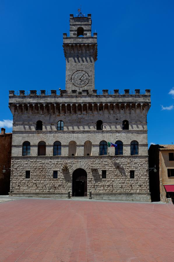 Town hall Civica tower Piazza Grande square, Montepulciano, Tuscany, Italy. The town or city hall with the Civica tower at the Piazza Grande in  Montepulciano royalty free stock photo