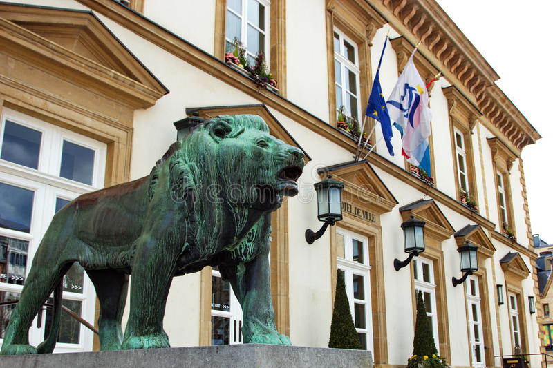 Town hall of Luxembourg. Lateral view of the town hall of Luxembourg city, Europe. in front of the building there are the sculptures of two lions stock photography