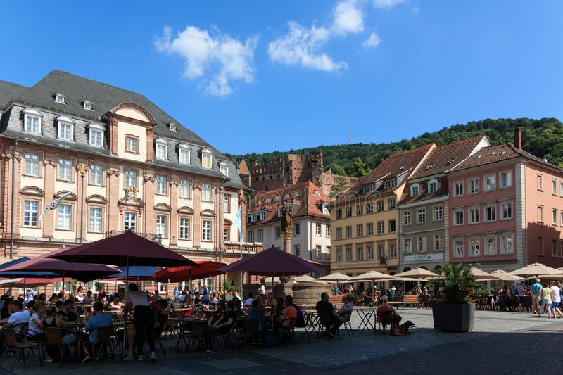 Town Hall at the market square in Heidelberg with the castle in the background, Baden-Wurttemberg, Germany royalty free stock image
