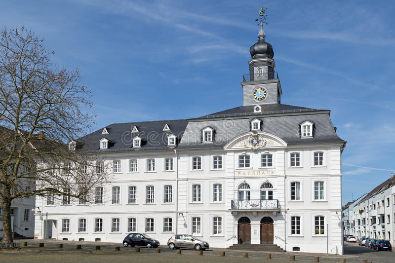 Town hall of Saarbrucken. SAARBRUCKEN, GERMANY - APRIL 10: The white Rathaus, the town hall of Saarbrucken on a sunny spring day. April 10, 2015 in Saarbrucken stock image