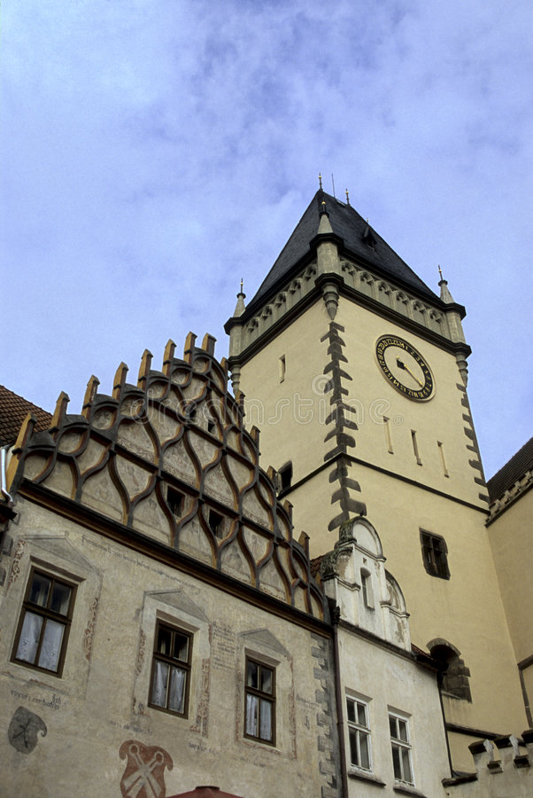 Town Hall- Tabor, Czech Republic. Gothic exterior of the Skock House w/ tower of the Town Hall in distance viewed from the Central Square (Zizkovo namesti) royalty free stock photography