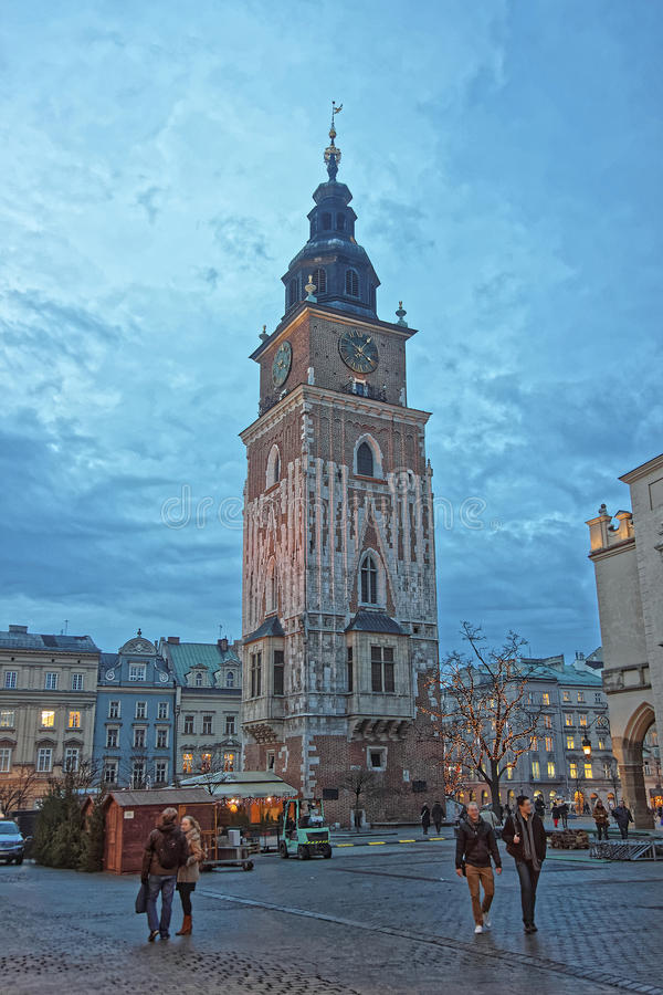 Town Hall Tower in the Main Market Square of the Old City in Krakow in Poland at Christmas. KRAKOW, POLAND, JANUARY 10, 2014: Hall Tower in the Main Market stock photo
