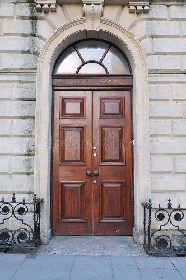 Town House Doorway. Large Wooden Doors of a Luxurious Town House royalty free stock photography