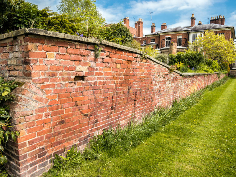 Town House Walled Garden. The walled garden of a large town house on the edge of a park. Shrewsbury, Shropshire, England stock image