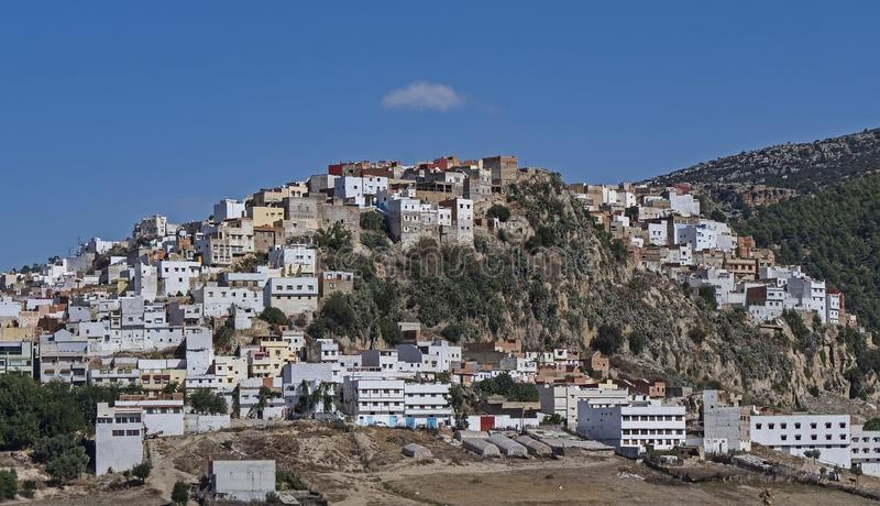 Scenic Town Outside of Meknes, Morocco. A town just outside of Meknes, Morocco rests on a verdant hill royalty free stock image
