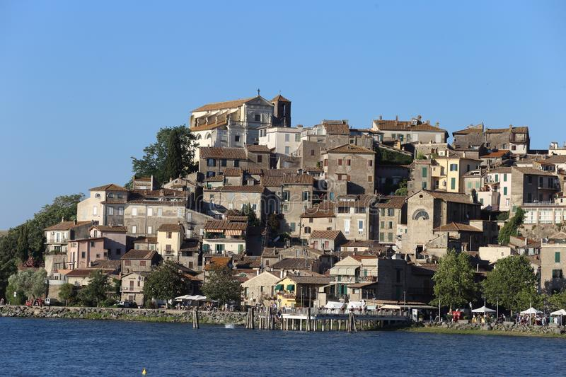 The town and Lake Bracciano with tourists stock photo
