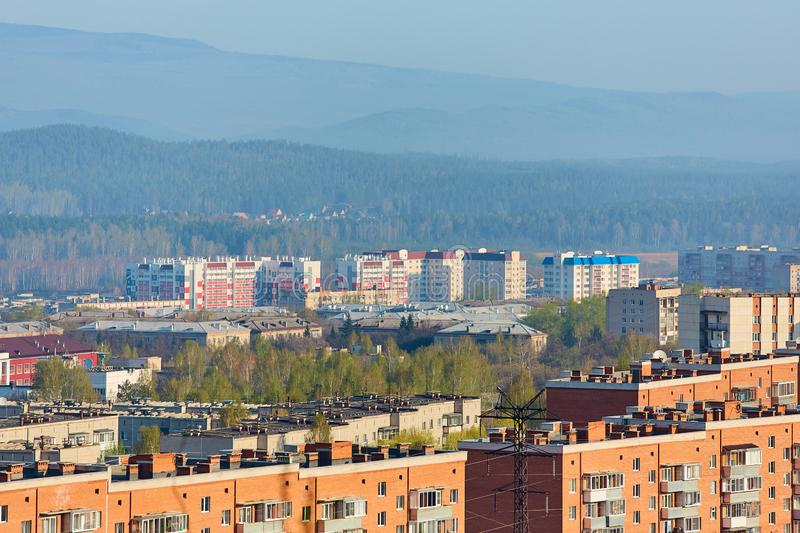The town Miass , is located in Chelyabinsk oblast, Russia. In the background, the Ural mountains, Ilmen ridge and the village of. Turgoyak stock images