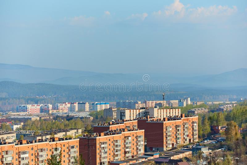 The town Miass , is located in Chelyabinsk oblast, Russia.  In the background, the Ural mountains, Ilmen ridge and the village of. The town Miass , is located in royalty free stock images