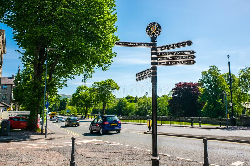 Town signpost showing directions to various places Kendal royalty free stock images