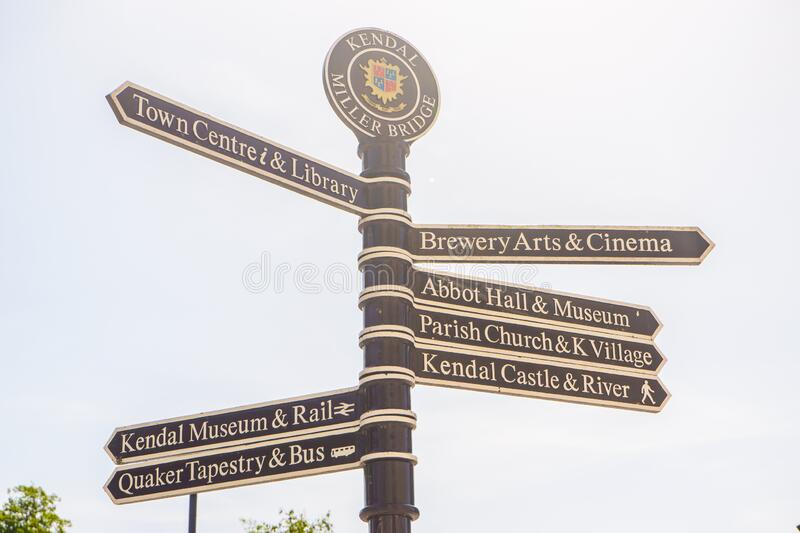 Town signpost showing directions to various places Kendal royalty free stock photography
