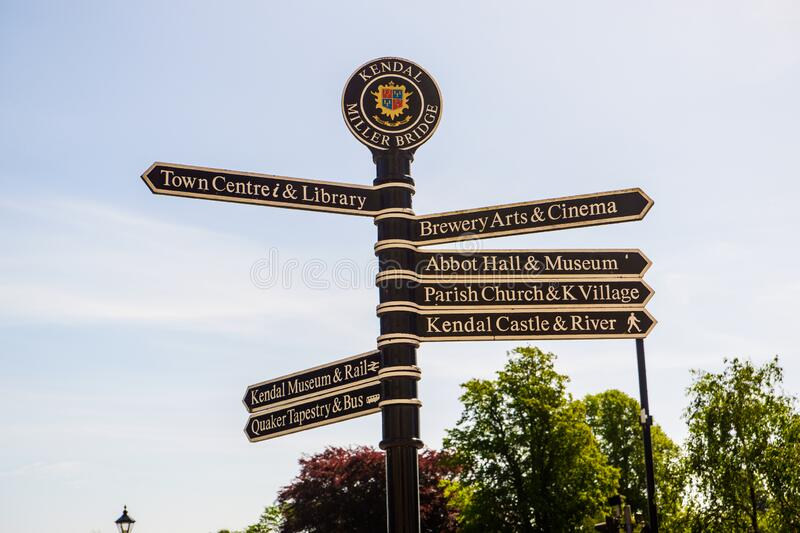 Town signpost showing directions to various places Kendal stock photos