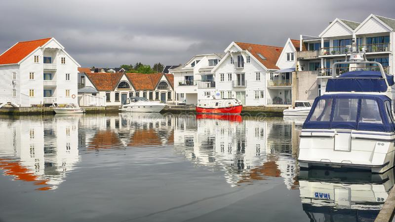 Town Skudeneshavn, Norway. Skudeneshavn, Norway 07/19/2019  : Marina in the Norwegian town Skudeneshavn. Old Skudeneshavn is one of the most well kept old towns royalty free stock photos
