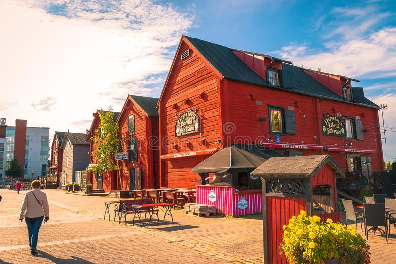 Town Square market in Oulu Finland. Red wooden buildings in the town market square in Oulu Finland royalty free stock image