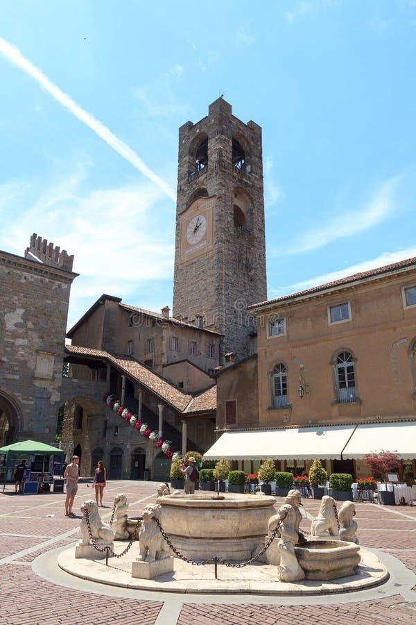 Town square Piazza Vecchia and old city tower Torre Civica in Bergamo, Citta Alta stock images
