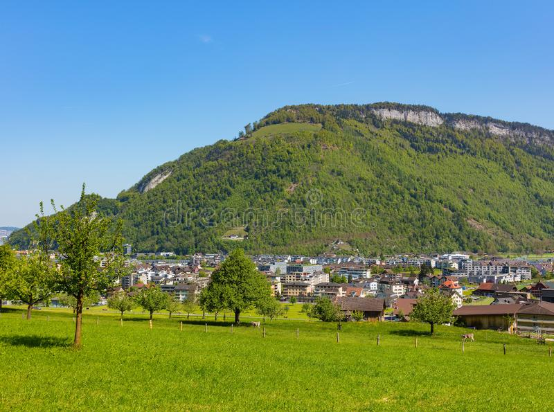 Town of Stans in Switzerland. The town of Stans in Switzerland as seen from the foot of Mt. Stanserhorn at the beginning of May. The town of Stans is the capital royalty free stock images