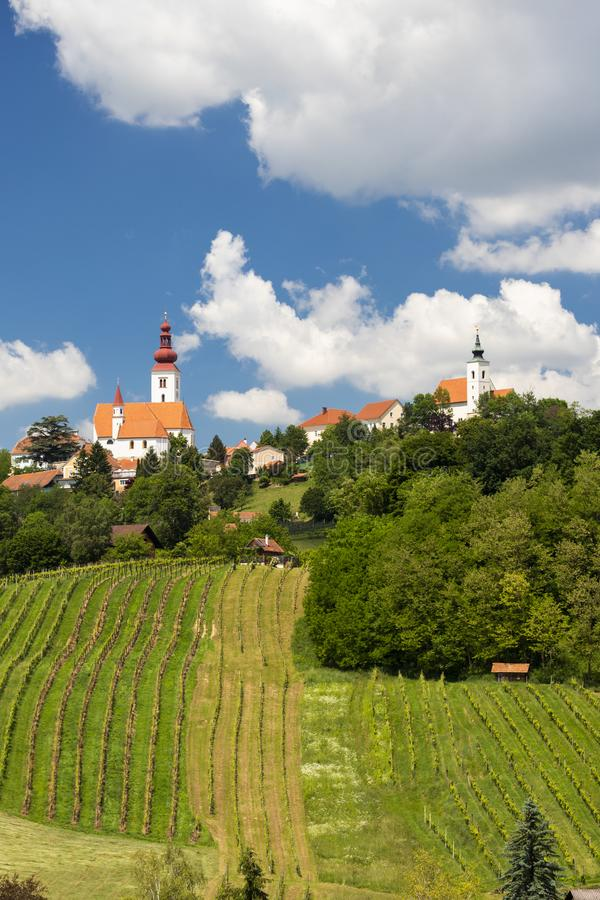 Town Straden and wineyards in Styria, Austria. Architecture, attraction, building, center, christmas, church, city, cold, colorful, countryside, europe, fog stock image