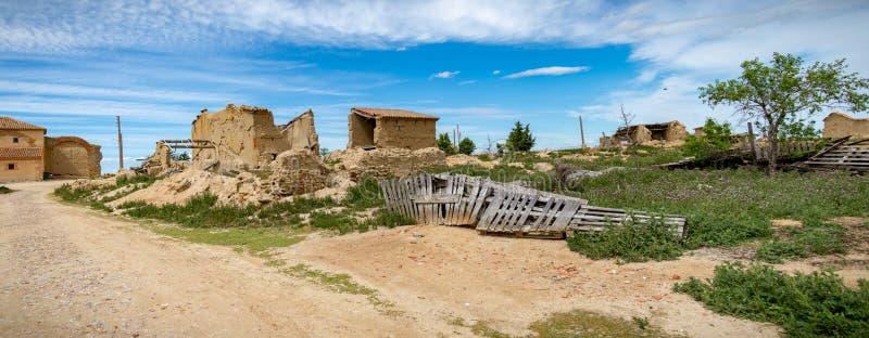 Town stuck in La Espana Vaciada. Houses demolished at sunset. Otero de Sariegos, Zamora royalty free stock photography