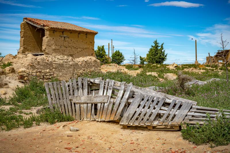 Town stuck in `La Espana Vaciada`. Houses demolished at sunset. Otero de Sariegos, Zamora royalty free stock images
