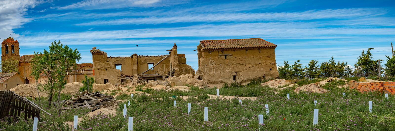 Town stuck in `La Espana Vaciada`. Houses demolished at sunset. Otero de Sariegos, Zamora royalty free stock photos