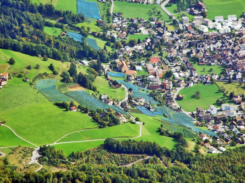 The town of Walenstadt on the shore of Lake Walensee and in the valley of Seez river or in the valley of Seeztal stock photo