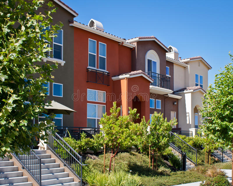 Townhomes. A row of new townhomes with yellow, gray, and dark red exteriors royalty free stock photography