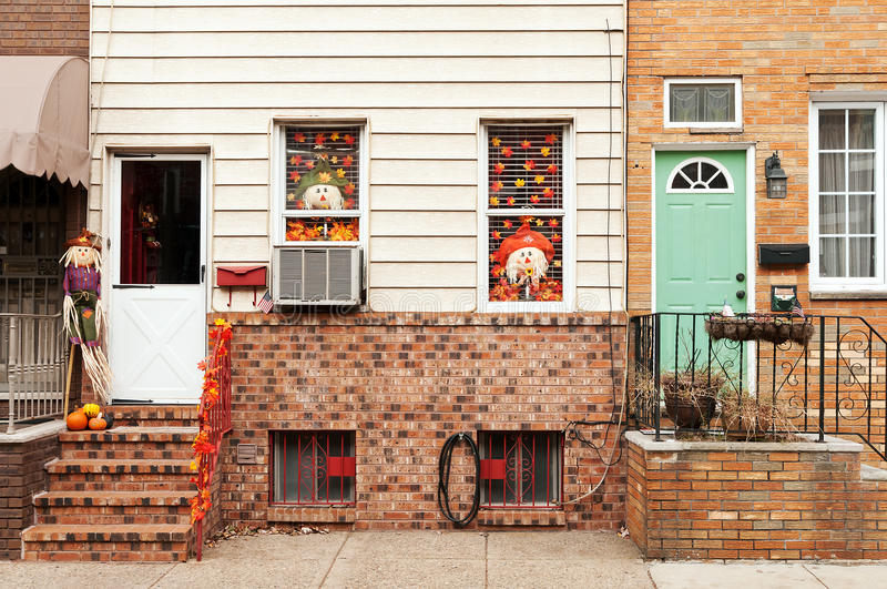 Townhouses decorated for fall festival stock photos