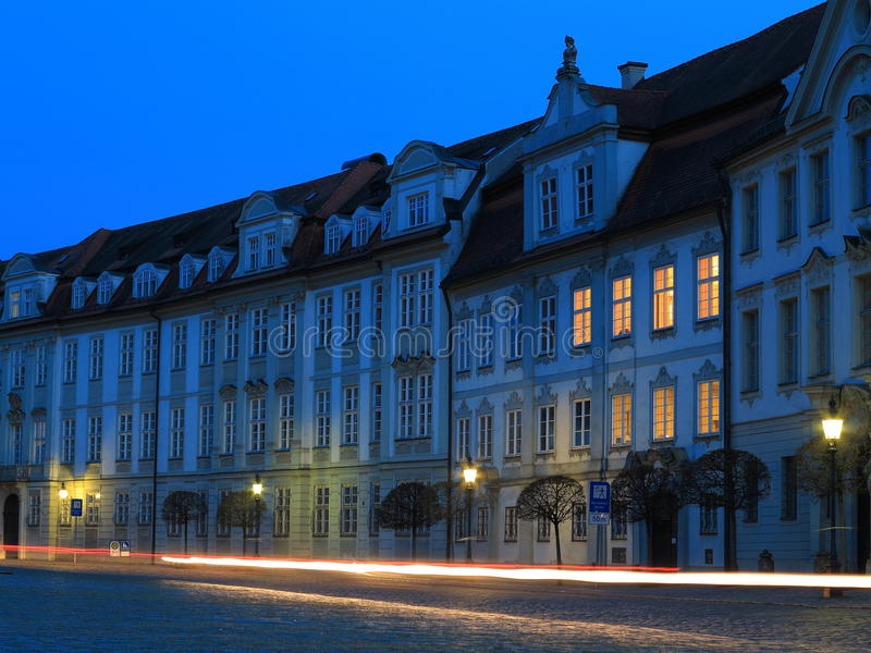 Moving traffic in old town by twilight. Night shot at the blue hour showing the historic residence of the city Eichstätt (Germany) with moving royalty free stock image