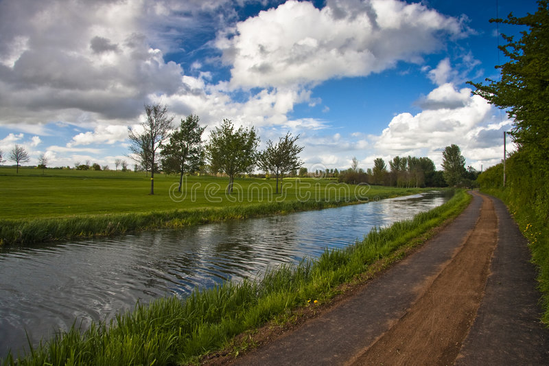 Towpath and golf course by canal. The bridgwater and taunton canal next to a golf course stock photos
