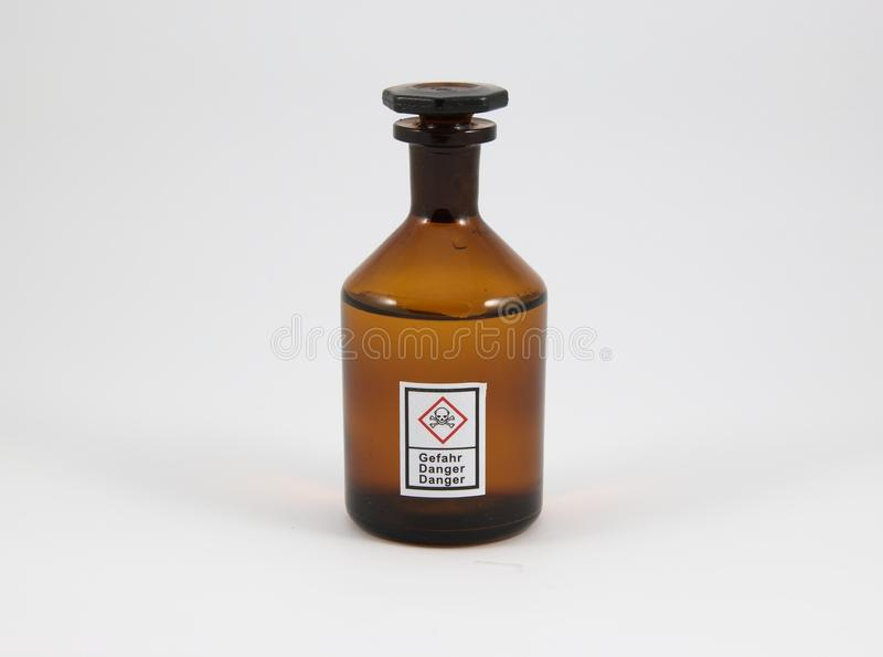 Toxic. The image shows a chemical flask with the new GHS-Icon Toxic on it royalty free stock photo