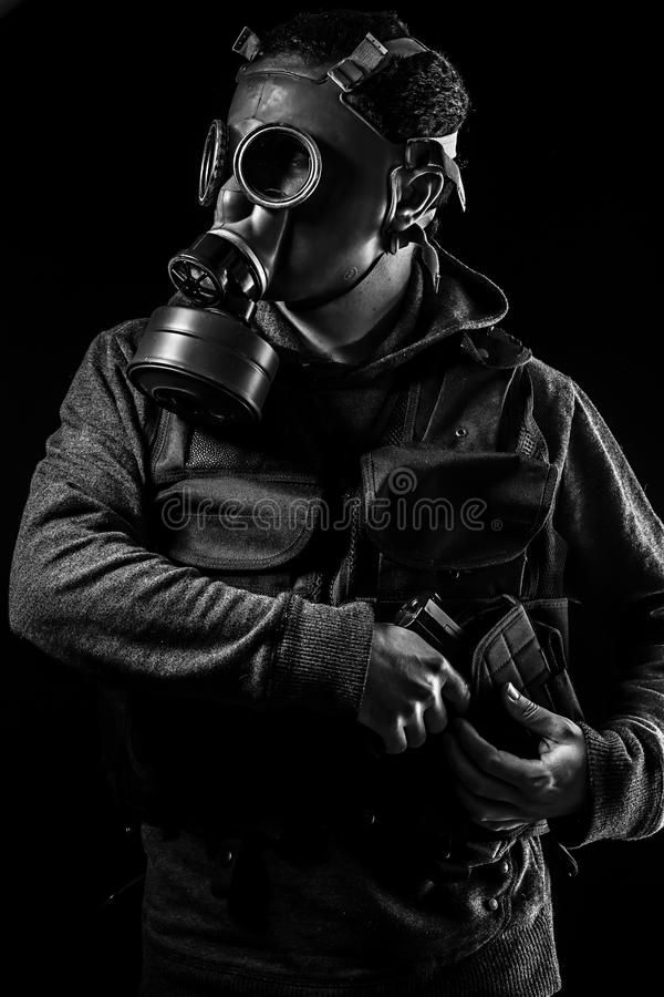 Toxic attack. A man in a gas mask in the smoke. artistic background royalty free stock photo