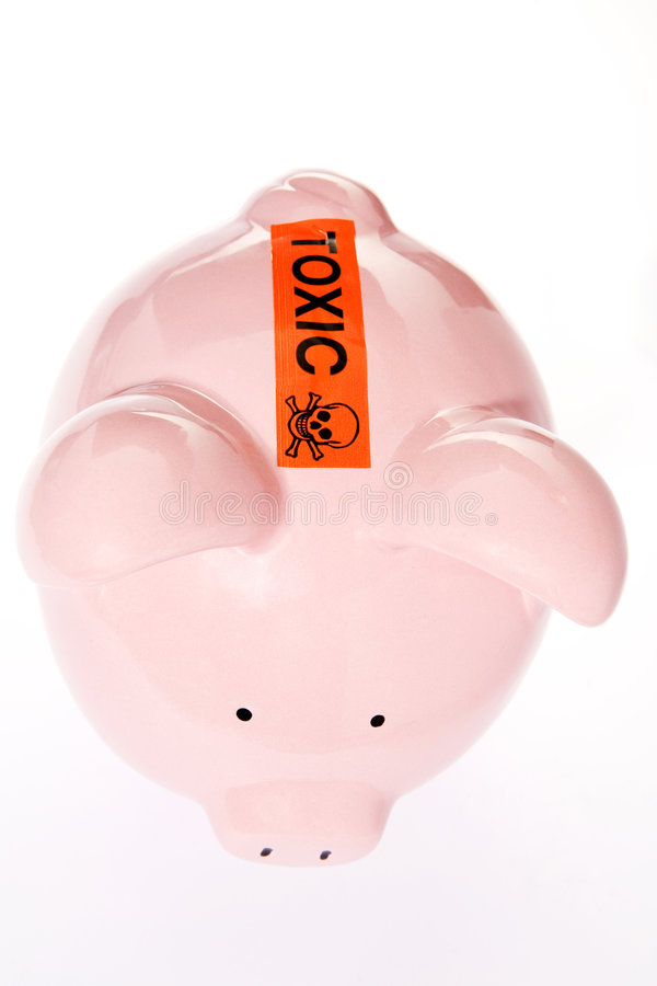 Toxic Debt Concept. Piggy Bank With Toxic Warning Over Slot royalty free stock photo