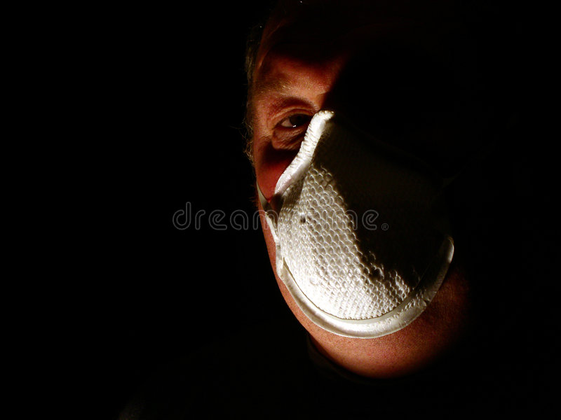 Toxic man. A man with a toxic gas mask stock photos