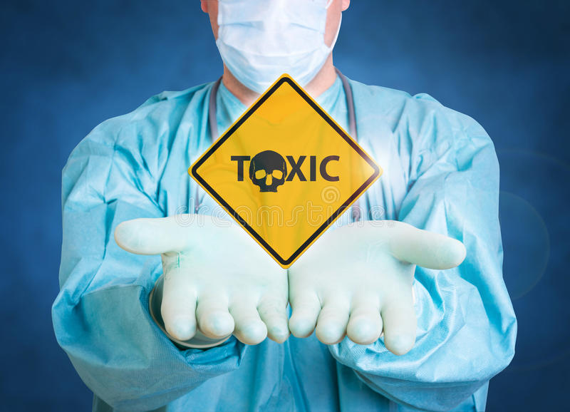 Toxic medical background with doctor. Medical background doctor with a tcoxic sign stock photography