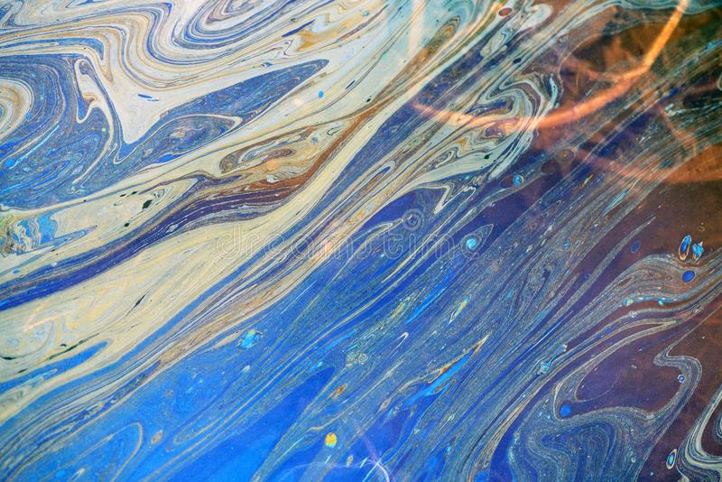 Toxic Oil Chemical Spill on Water Surface. Toxic colours of oil and water in a chemical spill creating a psychedelic blur of rainbow colours. Copyspace area for royalty free stock images