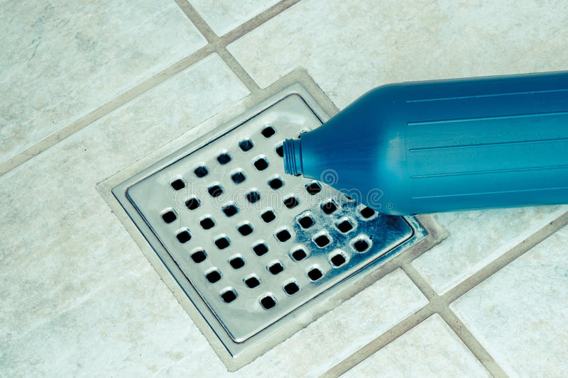 Toxic waste. Running down the drain royalty free stock image
