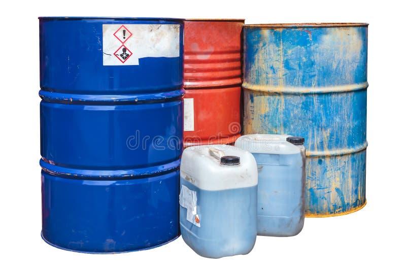 Toxic waste barrels isolated on white. Rusty toxic waste barrels isolated on a white background royalty free stock photo