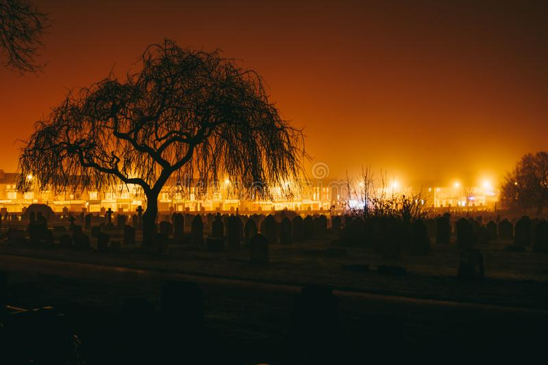 Toxteth Park Cemetery in the night, foggy night graveyard in Liverpool, UK royalty free stock photography