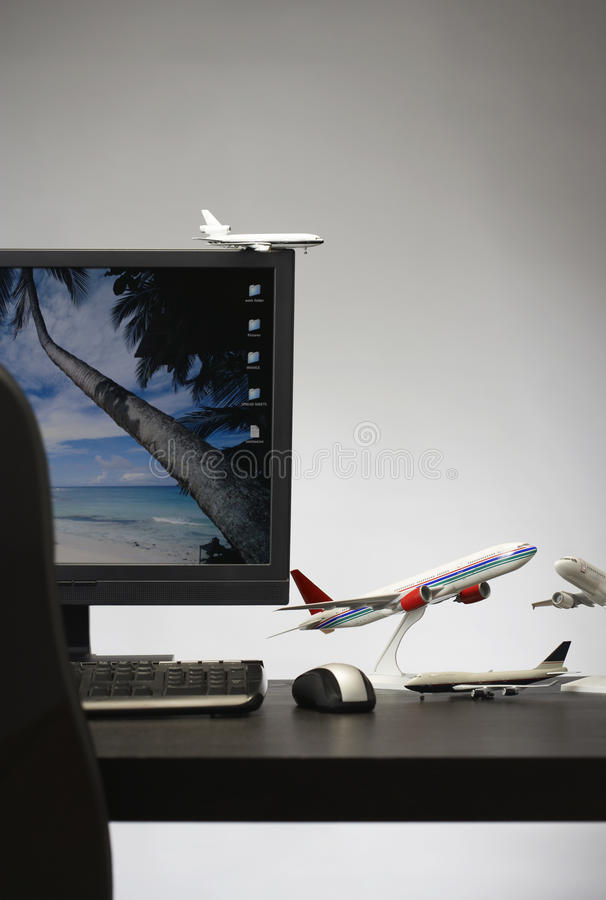 Toy aeroplane on office desk stock images