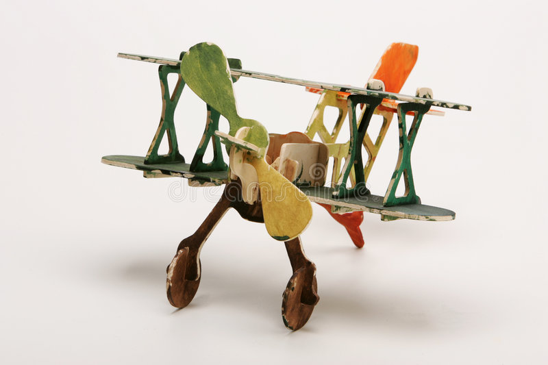 Toy aircraft. A plywood toy retro aircraft, of the tipe biplane, painted by a child stock photography
