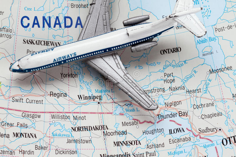 Toy Airplane on Map of Canada royalty free stock photo